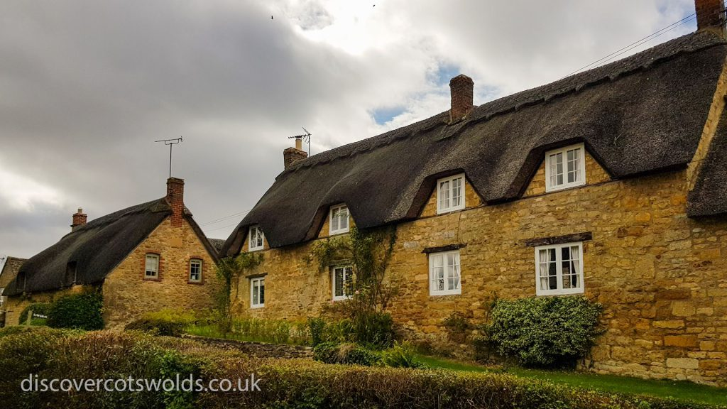 Traditional thatched cottages in the Cotswolds village of Ebrington
