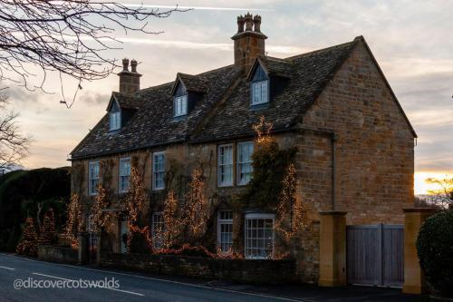 House in Broadway, Worcestershire, illuminated for Christmas