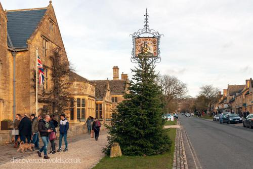 Lygon Arms Hotel, Broadway with a view of the high street and Christmas tree